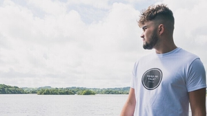 Ronan Patterson wearing a 'Need To Talk' t-shirt