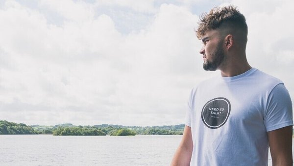 Ronan Patterson wearing a 'Need To Talk' t-shirt