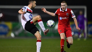 Michael Duffy of Dundalk in action against Sean Quinn of Shelbourne