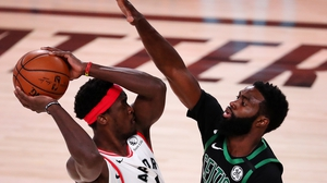 Pascal Siakam of the Toronto Raptors is challenged by the Boston Celtics' Jaylen Brown