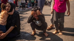 A boy reacts after police fired teargas