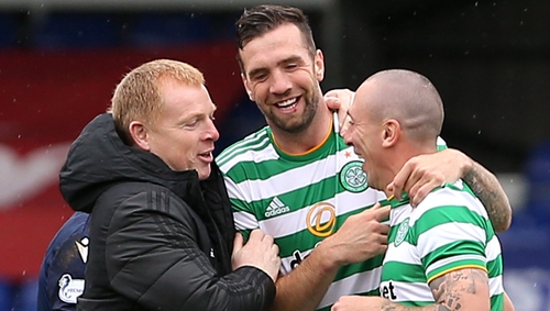 Duffy (C) celebrates with manager Neil Lennon (L) and captain Scott Brown