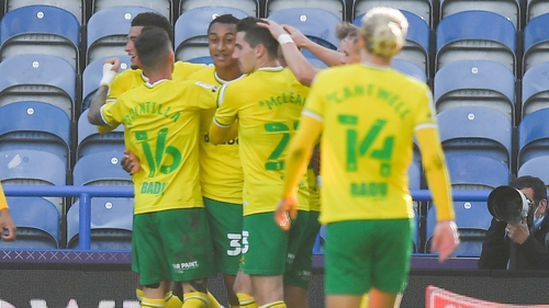 Adam Idah celebrates with his Norwich team-mates as they won on the opening day at Huddersfield