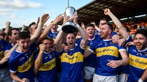 David Lavery, holding the trophy, celebrates with his teammates