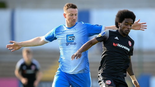 Walter Figueira of Derry City in action against Shane McEleney of Finn Harps