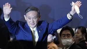 Yoshihide Suga acknowledges the crowd as he is elected new head of Japan's ruling party the LDP