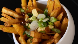 Irish Cheddar Cheese Curd Poutine with Smoked Bacon & Whiskey Gravy.