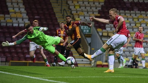 Lincoln City's Anthony Scully scores his side's second goal in their drubbing of Bradford