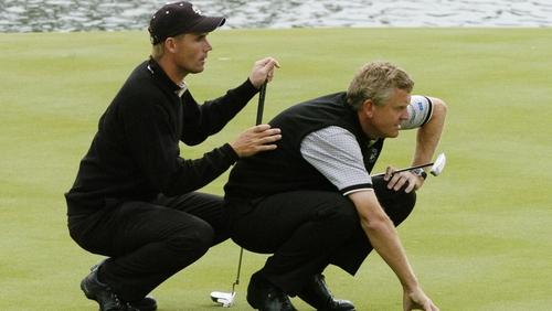 Padraig Harrington and Colin Montgomerie line up a putt