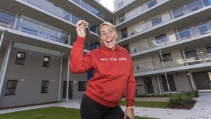 Sinead Fay, one of the 25 previous residents, celebrates getting her keys