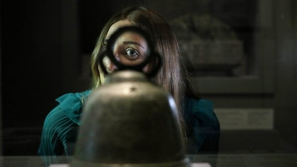 Deirdre Geraghty looking at an 8th/9th century hand bell, which was found near Glendalough