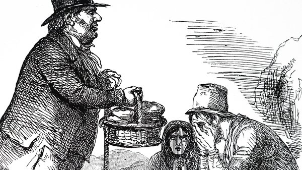 John Bull hands food to a listless Irish family (Photo by: Universal History Archive/Universal Images Group via Getty Images)