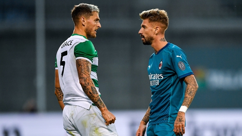 Lee Grace and AC Milan's Samuel Castillejo exchange viewpoints during the Europa League qualifier at Tallaght Stadium