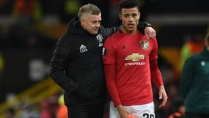 Ole Gunnar Solskjaer (L) and Mason Greenwood