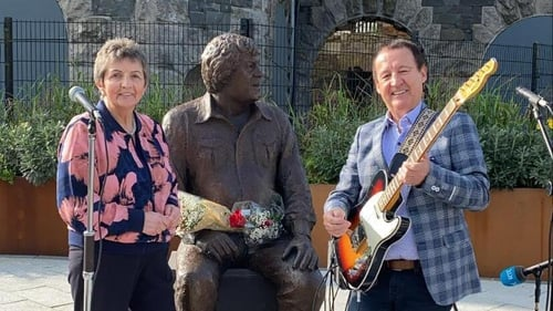 Margo O'Donnell and Declan Nerney performing beside Big Tom statue in Castleblayney today