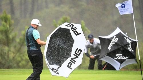 Daniel Young of Scotland wrestles with his umbrella in Obidos
