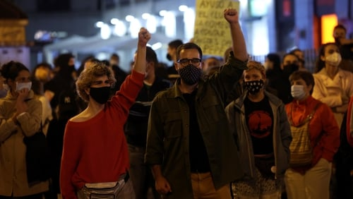 Hundreds of people take part in a spontaneous march at Puerta del Sol, in Madrid, Spain, this evening