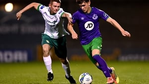 Cabinteely's Shane Barnes gets to grips with 15-year-old Shamrocks Rovers prospect Kevin Zefi