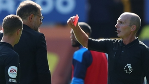 Referee Mike Dean shows Slaven Bilic a red card at Goodison Park