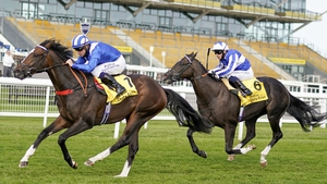 Jim Crowley and Alkumait (L) on their way to winning the Dubai Duty Free Mill Reef Stakes from Silvestre De Sousa and Fivethousandtoone