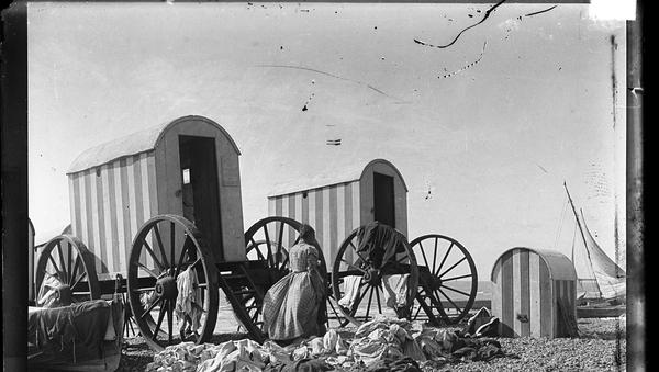Bathing machines on a beach circa 1900.Photo: RTÉ Photographic Archive