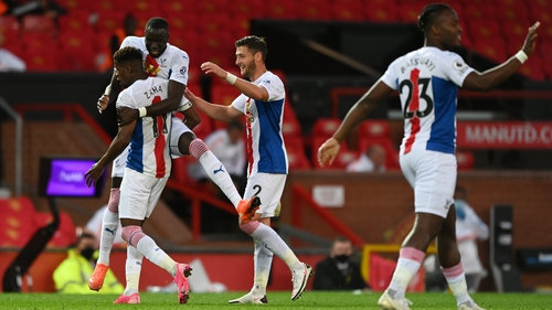 Wilfried Zaha is mobbed after scoring Crystal Palace's third goal