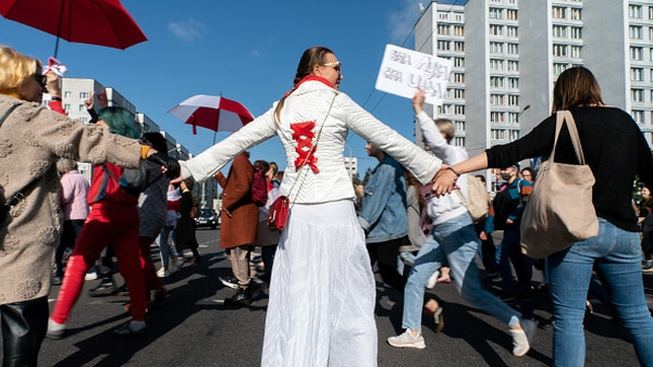 Belarusian women have taken to the streets with flowers and flags to demand change