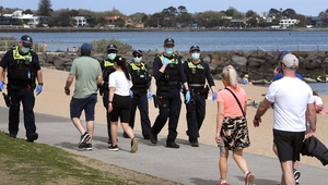 Police patrol Elwood Beach during an anti-lockdown protest in Melbourne