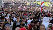 People march during a demonstration called by opposition movement for an end to the regime of Alexander Lukashenko