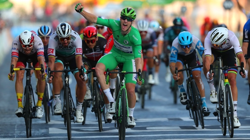 Sam Bennett sprints to victory on the Champs-Elysées