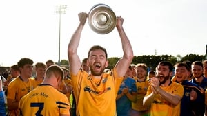Kevin McLoughlin of Knockmore lifts the cup following victory over Breaffy