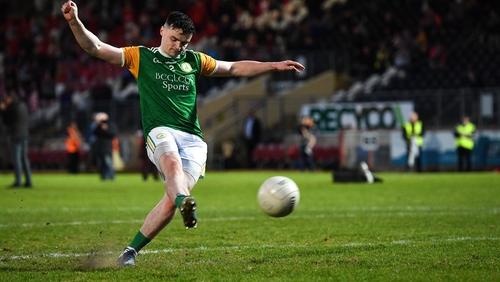 Ciaran Barker of Dungannon Thomas Clarkes kicks the winning penalty