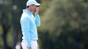 Rory McIlroy's final-round chances evaporated after he four-putted the first