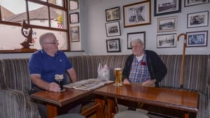 Gerry Lennon and Willie Irwin from Ballybay enjoying their first pints after lockdown in Ballybay, Co Monaghan