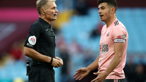 John Egan reacts after getting sent off by referee Graham Scott
