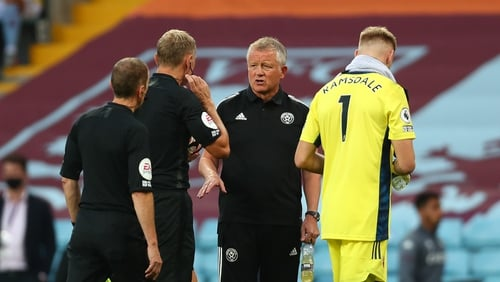 Chris Wilder was late for his post-match press conference after trying to quiz referee Graham Scott on the decision to send off John Egan