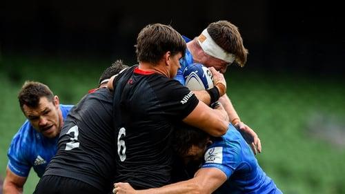 Michael Rhodes tackles Leinster's Ryan Baird
