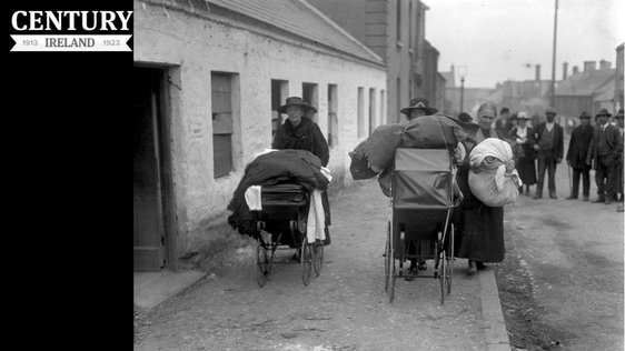 Three local women pushing prams, laden with clothes and blankets, leave Balbriggan, County Dublin, in the wake of the sack of that village after an attack by the Black and Tans on 20 September 1920. Photo: RTÉ Archives 0505/081