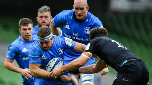 Sean Cronin of Leinster is tackled by Jamie George and Duncan Taylor of Saracens