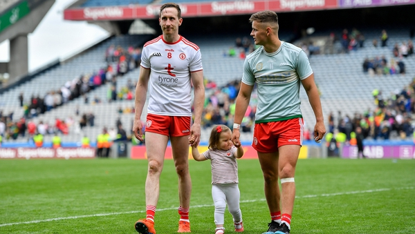 Colm Cavanagh and his daughter Chloe leave the Croke Park pitch with team-mate Michael McKernan after the 2019 All-Ireland semi-final against Kerry