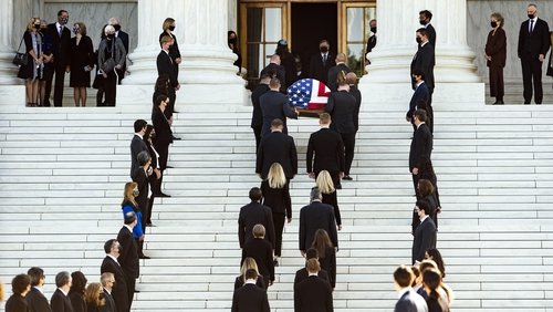 Pallbearers carry the flag-draped casket of the late US Supreme Court Justice Ruth Bader Ginsburg