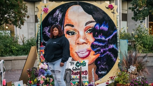 Tamika Palmer, mother of Breonna Taylor, poses for a portrait in front of a mural of her daughter in Louisville, Kentucky