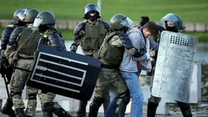 Law enforcement officers detain a man during an opposition rally in Minsk
