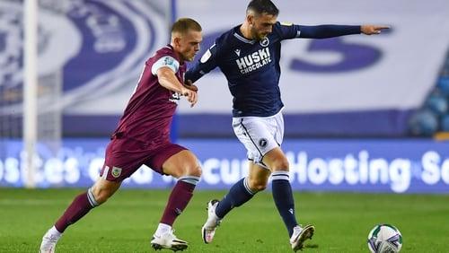 Josh Benson of Burnley challenges Millwall's Troy Parrott
