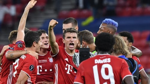 Thomas Muller (c) celebrates with his team-mates after winning the UEFA Super Cup