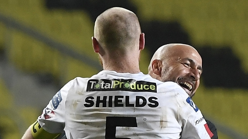 Filippo Giovagnoli and Chris Shields embrace after the penalty drama