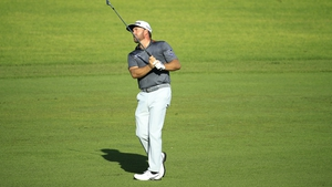 Graeme McDowell of Northern Ireland plays his second shot on the 13th hol