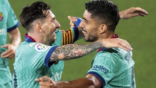 Leo Messi (L) with Luis Suarez