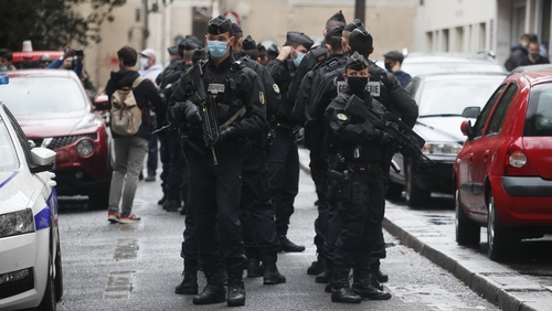 French security and medical workers on site after the attack in front of the former Charlie Hebdo headquarters in Paris
