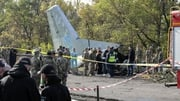 Rescuers inspect the crash site of the Antonov-26 plane in Kharkiv, Ukraine today